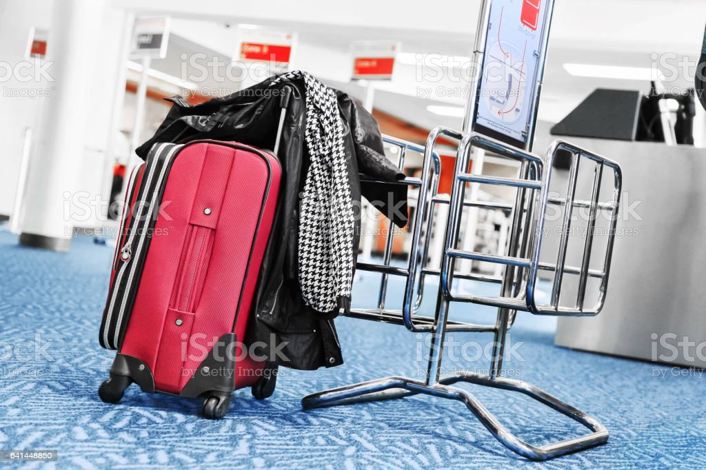 Travel suitcase at the airport stock photo