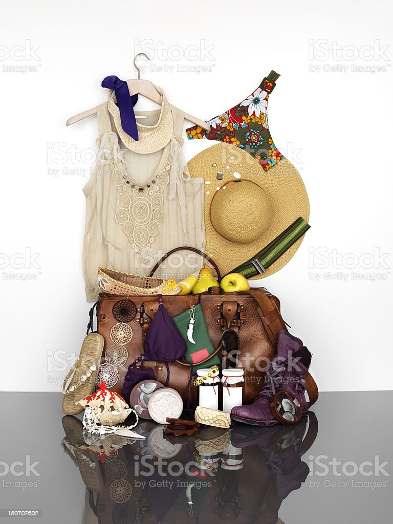 Travel suitcase packed for woman vacation with personal belongings royalty-free stock photo