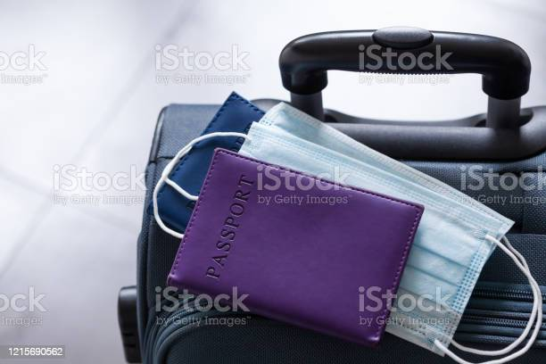 Travel suitcase passport and medical mask the ban on travel during picture id1215690562?b=1&k=6&m=1215690562&s=612x612&h=wcor2njpujmisvv 56uwtcnyaaxo1 3mmb bj244sy8=