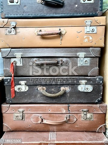 Vintage pilled leather suitcases