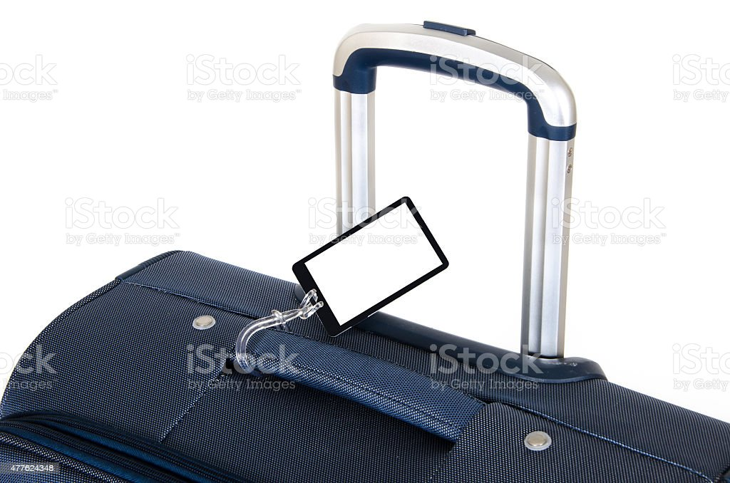 Travel suitcase with blank tag isolated on white stock photo