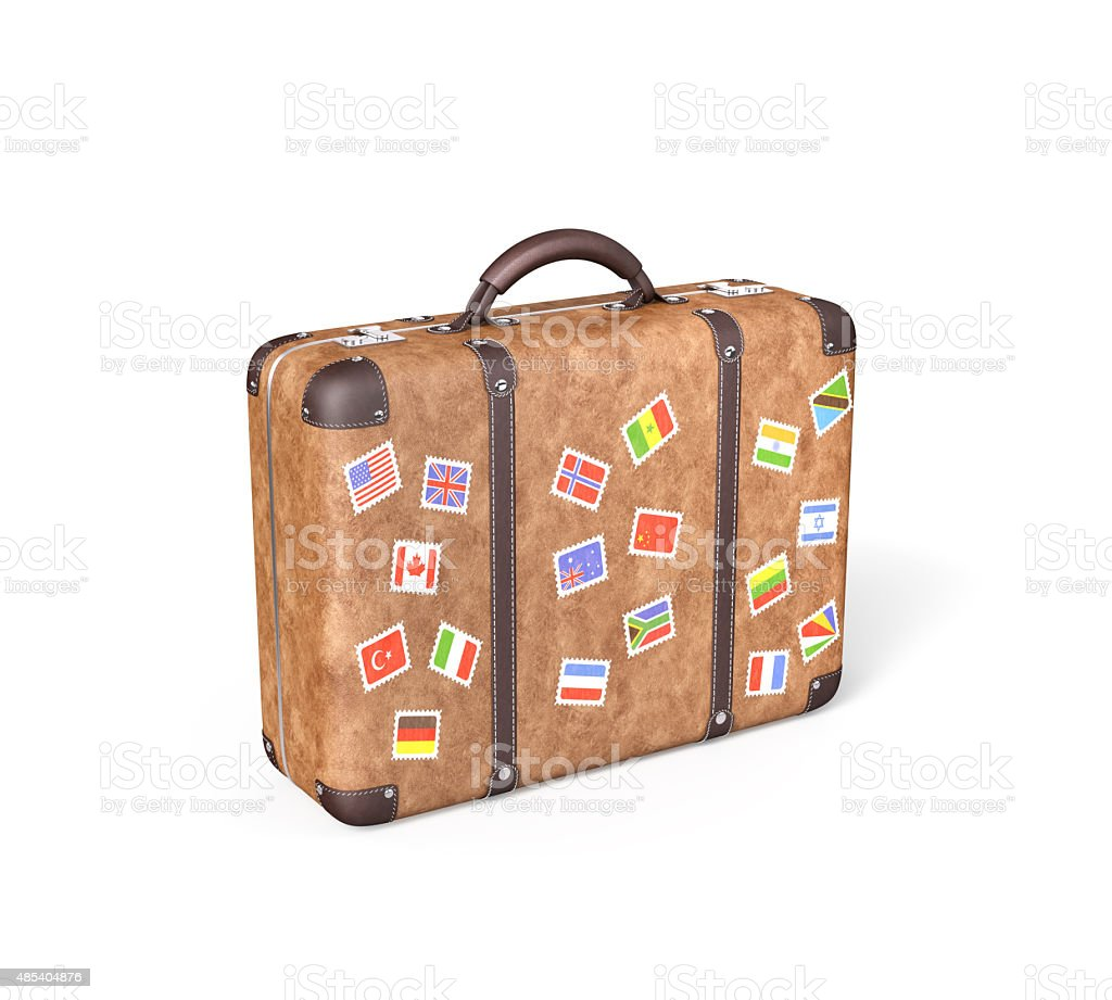 Travel Suitcase with flag stickers stock photo