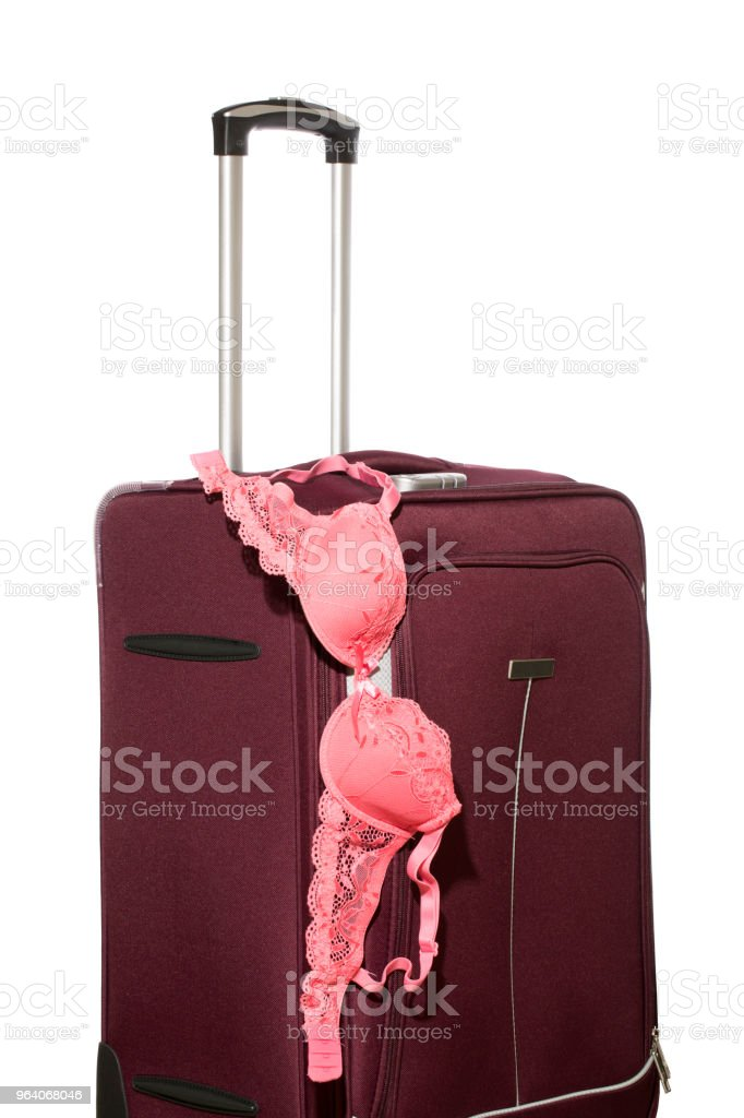 Travel suitcase with pull-out handle and female bra - Royalty-free Beauty Stock Photo