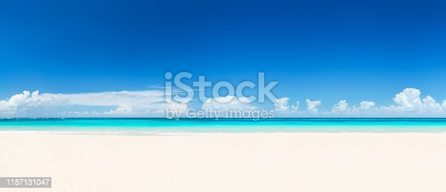 Beautiful sand beach in Punta Cana, Dominican Republic. Panorama of tropical beach with white sand and turquoise water. Travel summer holiday background concept.