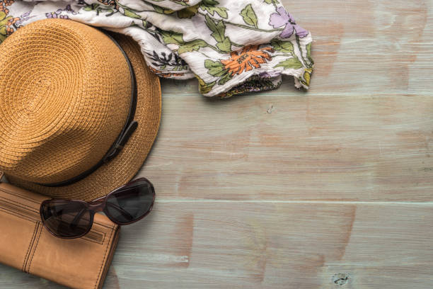 travel, summer vacation, tourism and objects concept - close up of hat, wallet, sunglasses and scarf on wooden table. top view with copy space. - phone, travelling, copy space imagens e fotografias de stock