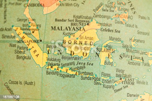 Studying Geography - Indonesia on retro globe.