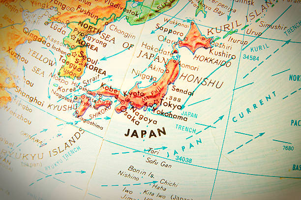 Travel the Globe Series - Japan Studying geography - Photo of Japan on retro globe. land feature stock pictures, royalty-free photos & images