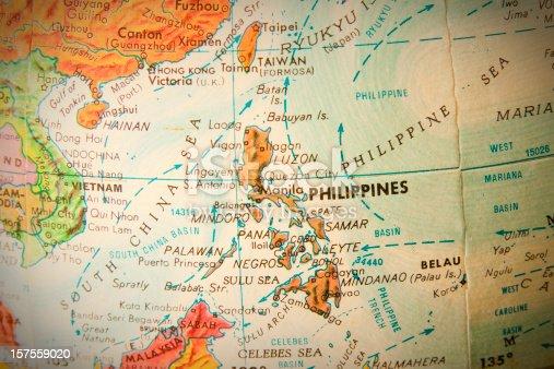 Studying geography - Photo of Philippines on retro globe.