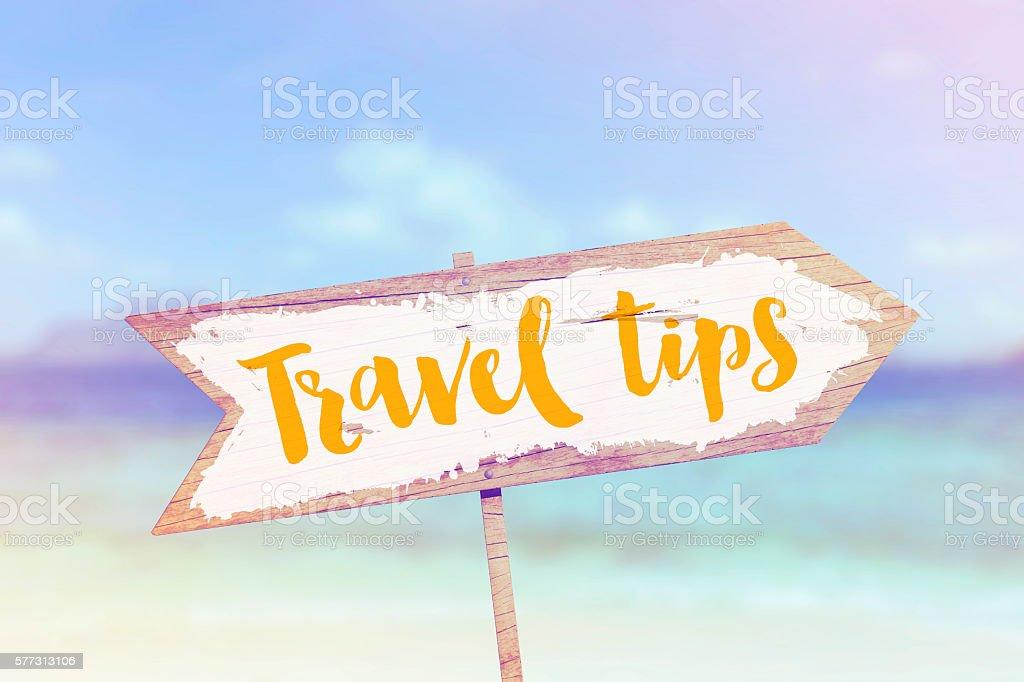 Travel tips summer wooden beach arrow sign stock photo