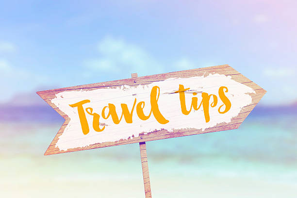 Travel tips summer wooden beach arrow sign stock photo