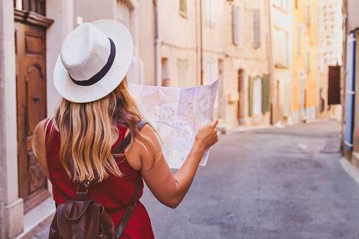 travel to Europe, tourist looking at map on the street, summer holidays
