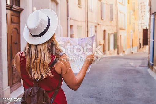 istock travel to Europe, tourist looking at map on the street, summer holidays 1020217050