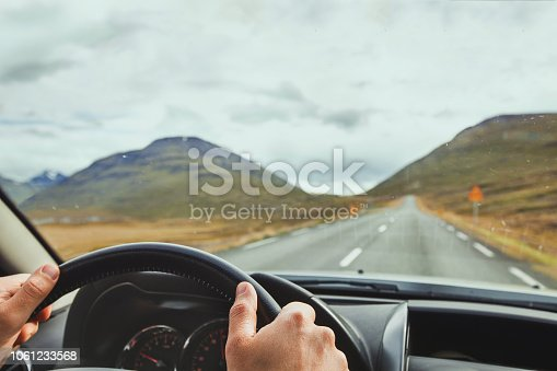 istock Travel to Iceland, driving car on a beautiful scenic road. 1061233568
