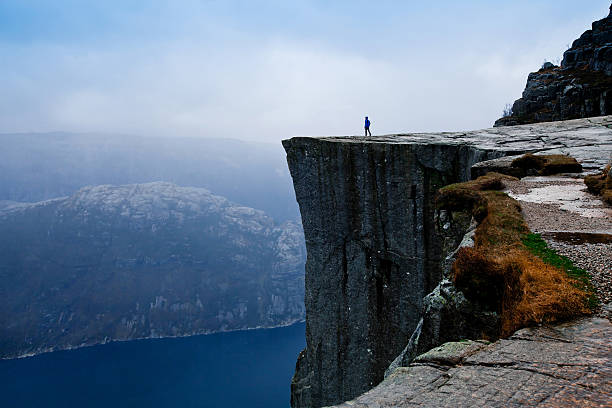 travel to norway, person looking on the fjords - majestueus stockfoto's en -beelden