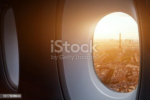 travel to Paris, view of Eiffel Tower from the window of airplane, holidays in France, Europe