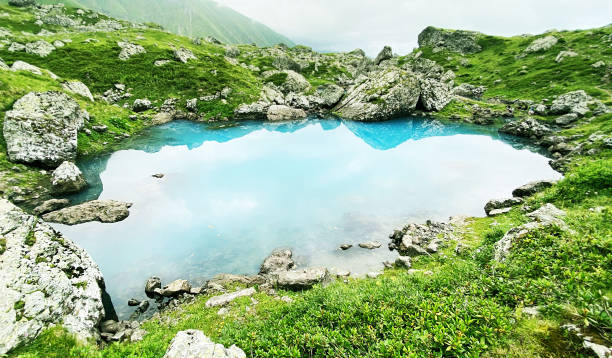 Travel to the mountainous region  of Georgia and blue lake stock photo