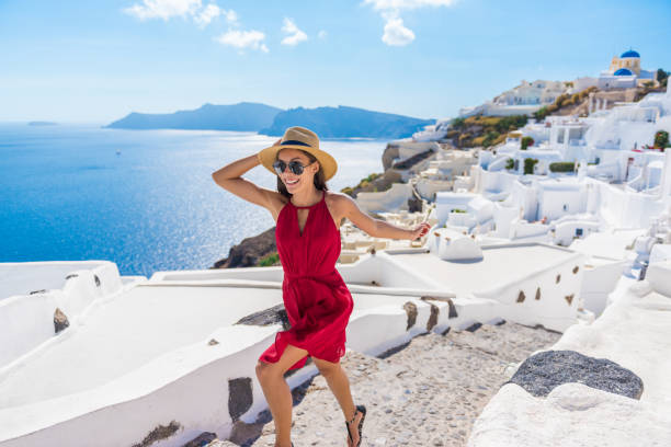 Travel Tourist Happy Woman Running Stairs Santorini stock photo