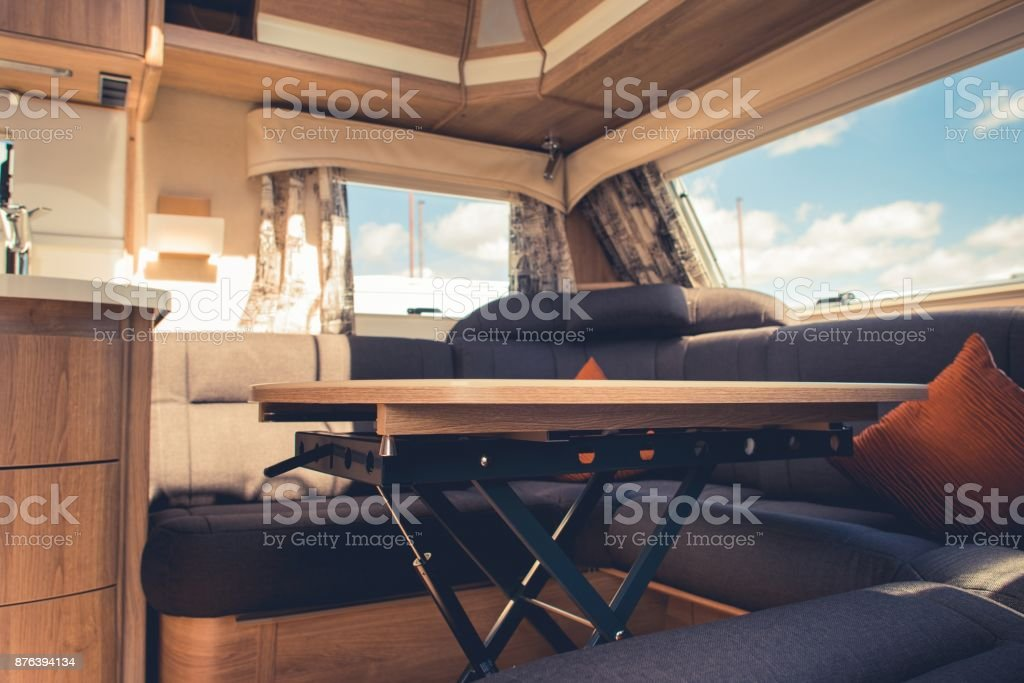 Travel Trailer RV Dining Area Travel Trailer RV Dining Area. Elegant Recreational Vehicle Interior. Camper Trailer Stock Photo