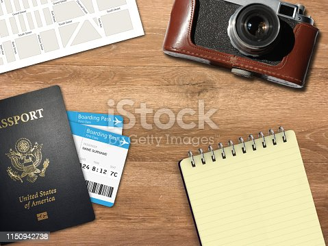 936373320 istock photo Travel trip planning desk top view map camera 1150942738