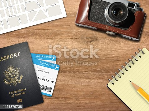 936373320 istock photo Travel trip planning desk top view map camera 1151379736