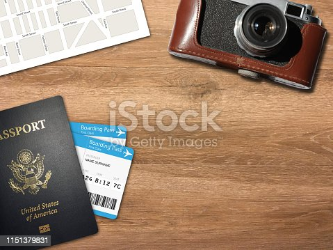 936373320 istock photo Travel trip planning desk top view map camera 1151379831