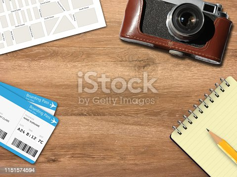 936373320 istock photo Travel trip planning desk top view map camera 1151574594