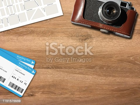 936373320 istock photo Travel trip planning desk top view map camera 1151575559