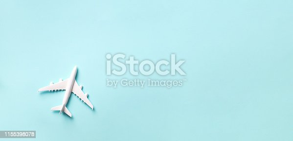 istock Travel, vacation concept. White model airplane on pastel blue color background with copy space. Top view. Flat lay. Minimal style design. Banner 1155398078
