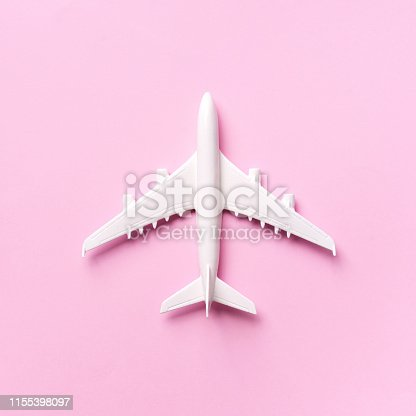 istock Travel, vacation concept. White model airplane on pastel pink color background with copy space. Top view. Flat lay. Minimal style design. Square crop 1155398097