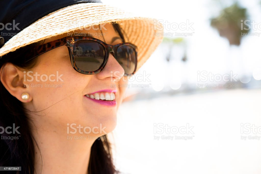 Travel Vacation:  Young woman wearing sunglasses on holiday. royalty-free stock photo