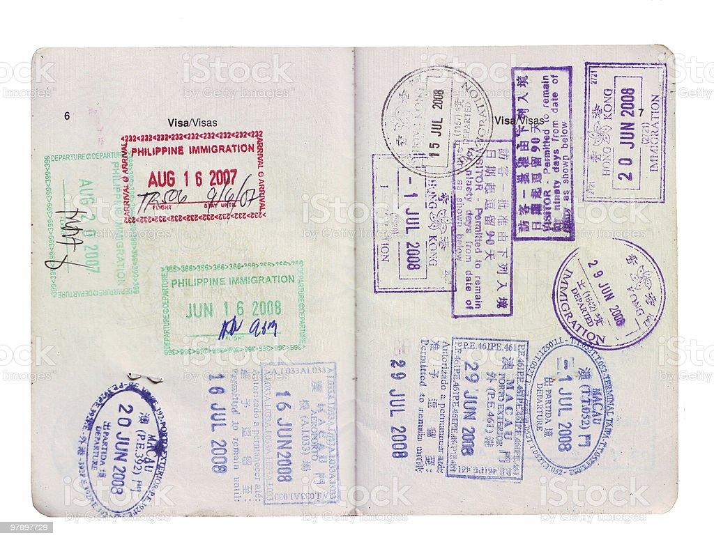 travel visa stamps on passport royalty-free stock photo