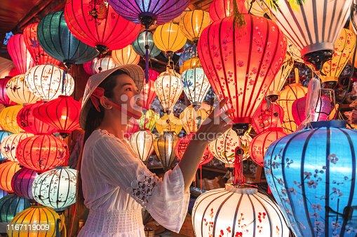 istock Travel woman choosing lanterns in Hoi An, Vietnam 1167119009