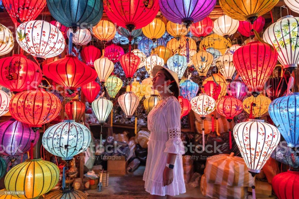 Travel Woman Choosing Lanterns In Hoi An Vietnam Stock Photo Download Image Now Istock