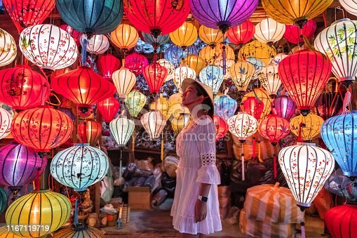 Travel woman choosing lanterns in Hoi An, Vietnam