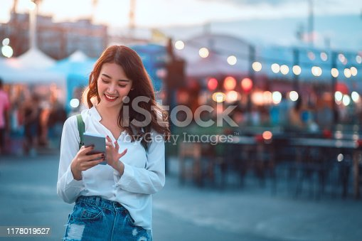 istock Travel woman in street market 1178019527
