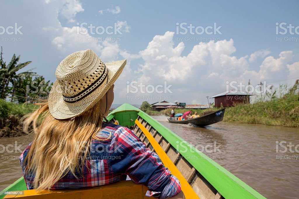 Travel woman on a longtail boat stock photo