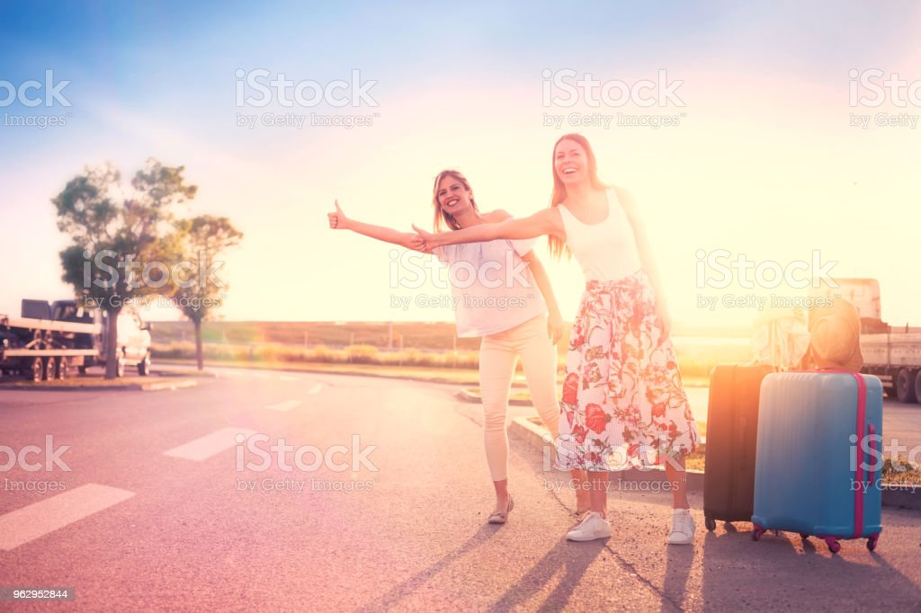 Travel women hitchhiking stock photo