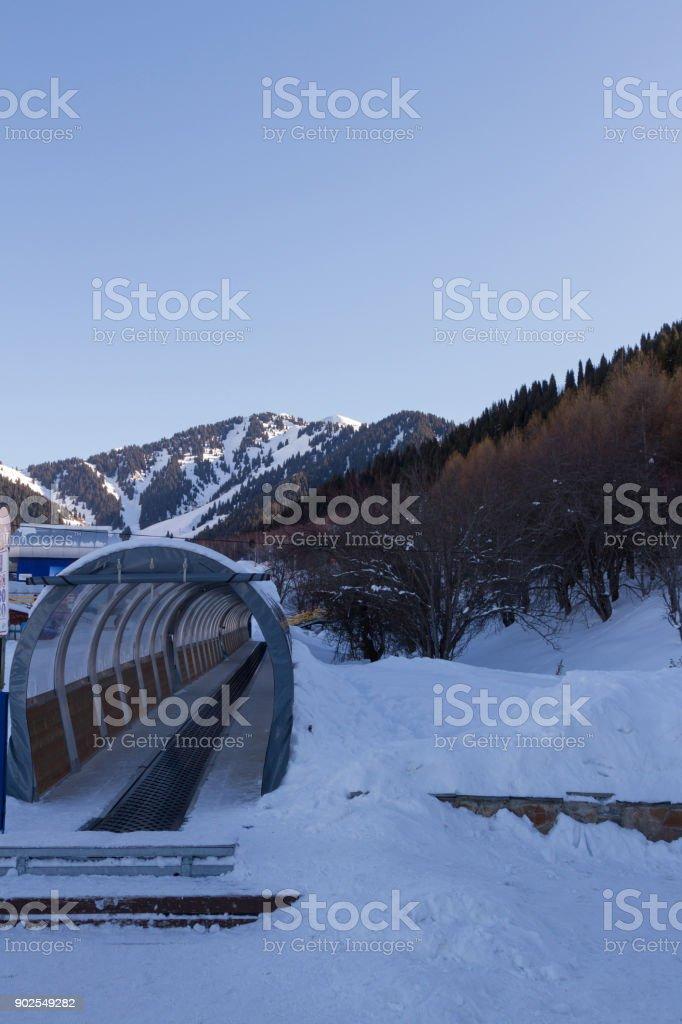 travelator to lift skiers stock photo