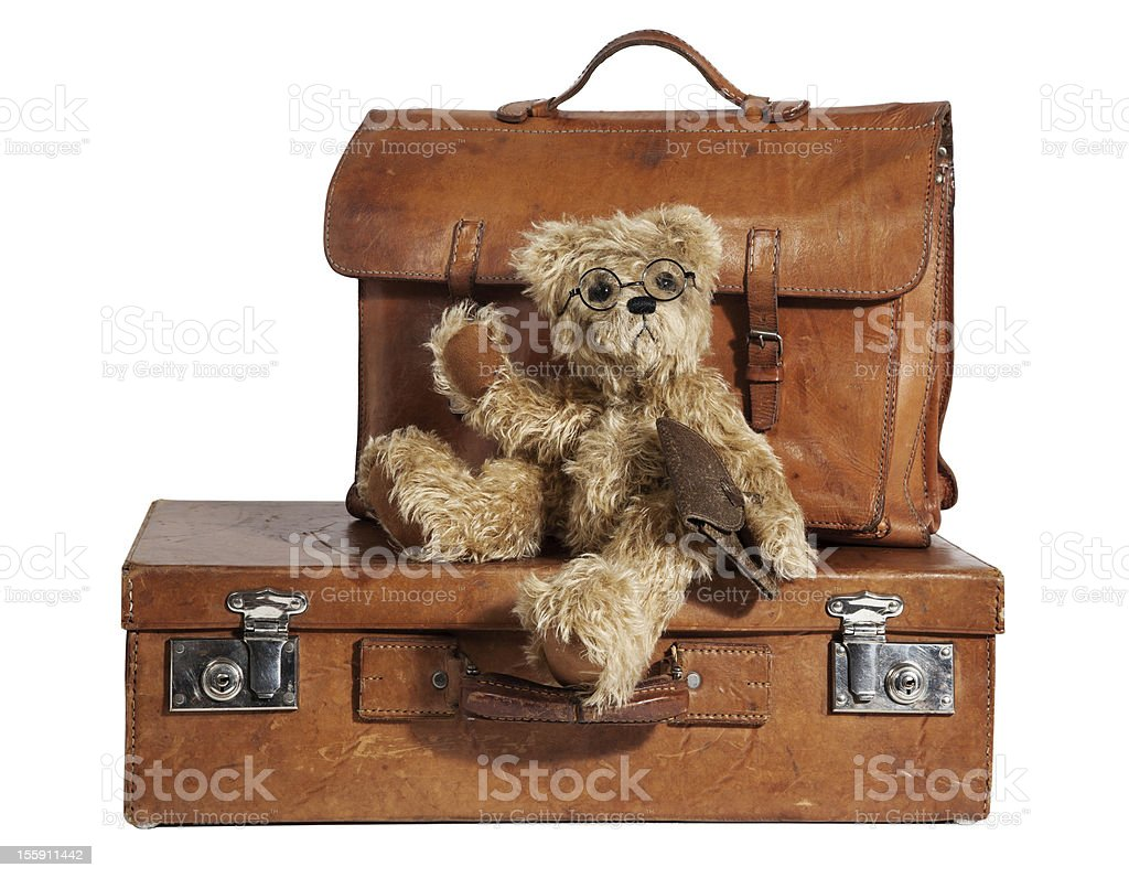 Traveled Vintage Suitcase and Teddy Bear royalty-free stock photo