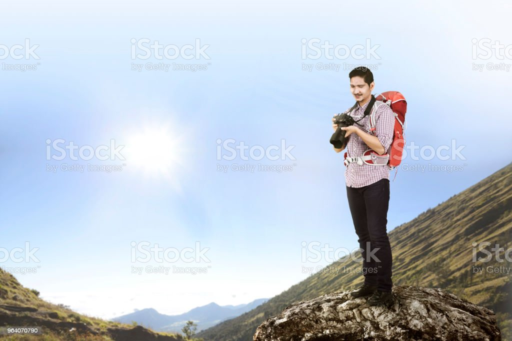 Traveler asian man with camera and backpack climb - Royalty-free Adult Stock Photo