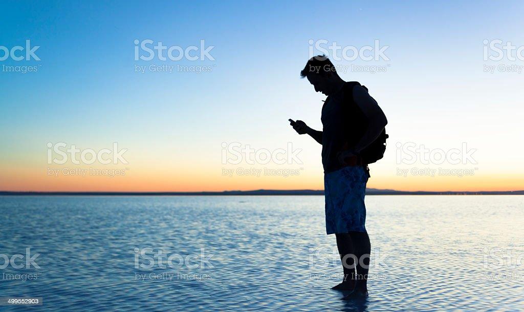 Traveler at Salt Lake stock photo