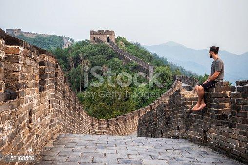 Traveler at the Great Wall of China near Beijing, China.