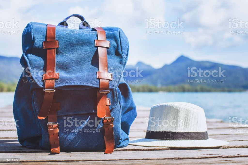 traveler backpack and hat, travel background with copy space стоковое фото