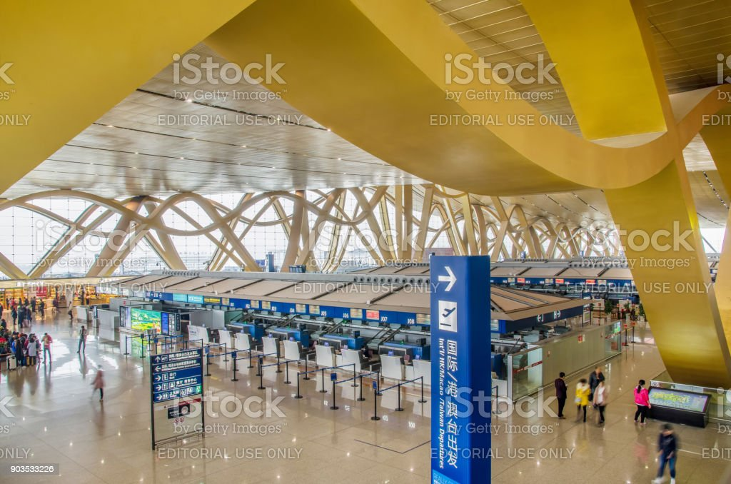 Traveler can seen exploring and walking around the Kunming Changshui International Airport.It is the primary airport serving Kunming,the capital of Yunnan Province,China. stock photo