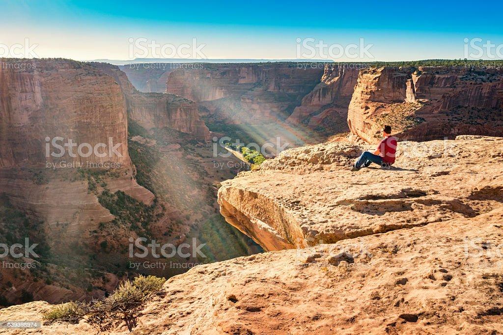 Traveler Contemplates at Canyon de Chelly National Monument Arizona stock photo