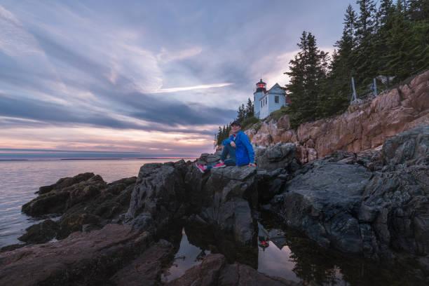 Traveler enjoying Acadia National Park landscape stock photo