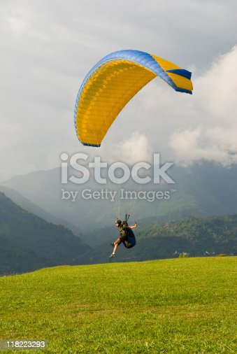 A traveler from Europe who is learning to paraglide in Colombia takes off from a hillside near Bucharamanga, Colombia