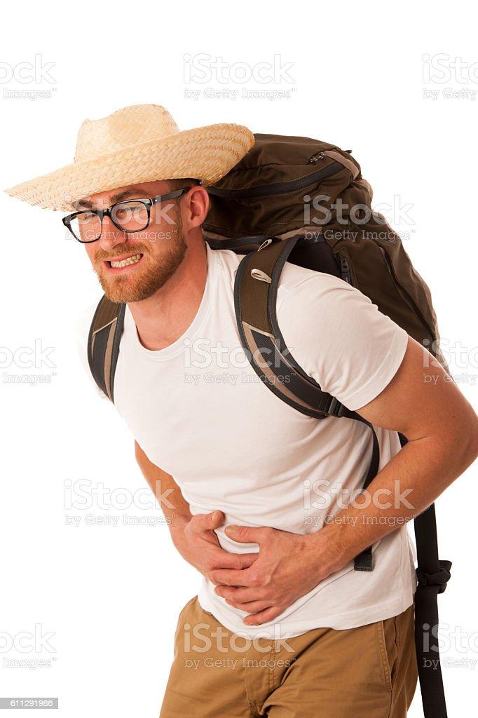 Traveler having stomach ache, nausea wearing straw hat stock photo