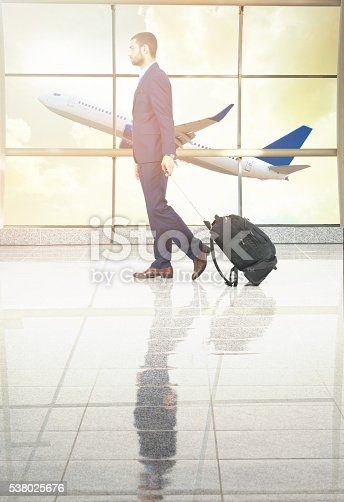 509630674 istock photo traveler in airport on sunset 538025676