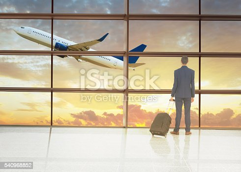 509630674 istock photo traveler in airport on sunset 540968852